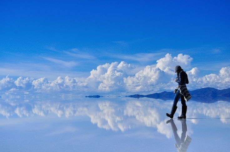"Salar de Uyuni, southwest Bolivia. ""Salar de Uyuni is the world's largest salt flat at 10,582 square kilometers. It is located in the Potosí and Oruro departments in southwest Bolivia, near the crest of the Andes and is at an elevation of 3,656 meters above mean sea level."""