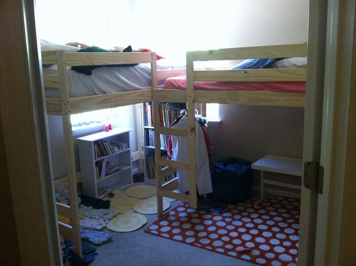 We did an Ikea Hack and turned Mydal bunk beds into L shaped Loft beds. My Hubby made a rope ladder that we still need to attach. I am happy to say I have 4 kids in one room plus space to play. I added a reading nook. Also I have my twin girls sleeping in the closet with the doors off..and some cool curtains to make it more fun for them. I still need to get some coordinating bedding and make some short curtains for the windows. Also need to dress the walls up a bit. :)