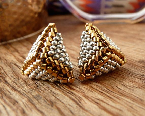 Petite Cuzco Pyramid Stud Earrings in Silver and Gold  These simply striking mini pyramid-shaped earrings are made from tiny sterling silver and 24k gold plated glass seed beads, which I have woven together one by one with a needle and thread.  I use only the highest quality materials, including hypoallergenic titanium posts (great for sensitive ears!)  The earrings measure 15mm across and come presented on a laser-engraved wooden card (see fourth image above).  Perfect for gift giving or as…