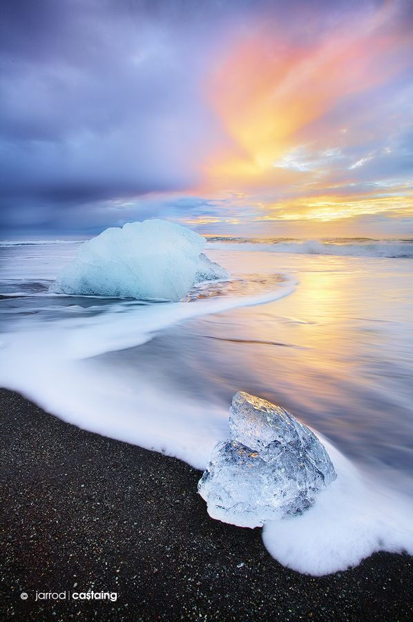 """Blue Ice"" by Jarrod Castaing, Sunrise at Jökulsárlón Beach, South Coast, Iceland"