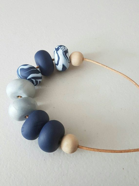 Check out this item in my Etsy shop https://www.etsy.com/au/listing/511491327/polymer-clay-bead-necklace-navy-blue-and