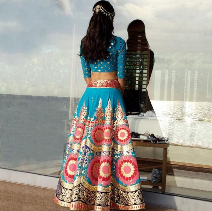 Neon hues, applique hearts and baroque embroidery. Melanie in a signature Manish Arora lehenga from Exclusively for her mehendi function.