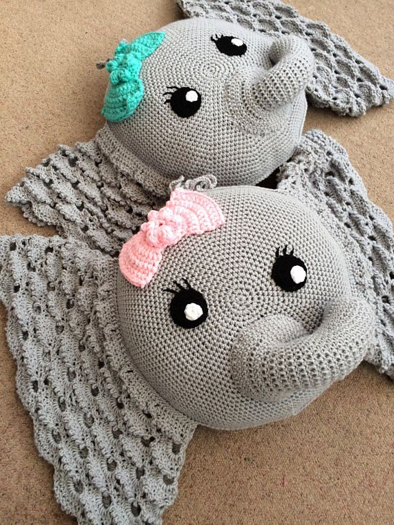 A soft and comfy elephant design cushion perfect for decorating a nursery or for soft play and reading time in a toy room. Great for any house with small children. Bow can be made in any colour Made using the fantastic pattern by IraRott. Made with acrylic yarn and polyester stuffing.