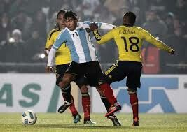 Argentina 0 Colombia 0 in 2011 in Santa Fe. Carlos Tevez goes past Juan Zuniga in Group A at Copa America.