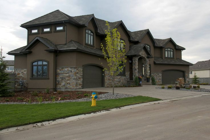 Dark brown stucco homes the stucco stone work on this - Brown exterior house paint ...