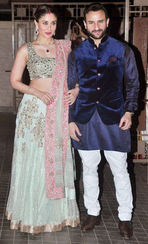 Soha Ali Khan's Wedding - Kareena Kapoor turned it up in a trendy mint green and pink (you guessed it) Manish Malhotra mirror work lehenga with Saif Ali khan in another bandhgala blue velvet jacket and white jodhpuri pants. Indian celebrity wedding #thecrimsonbride