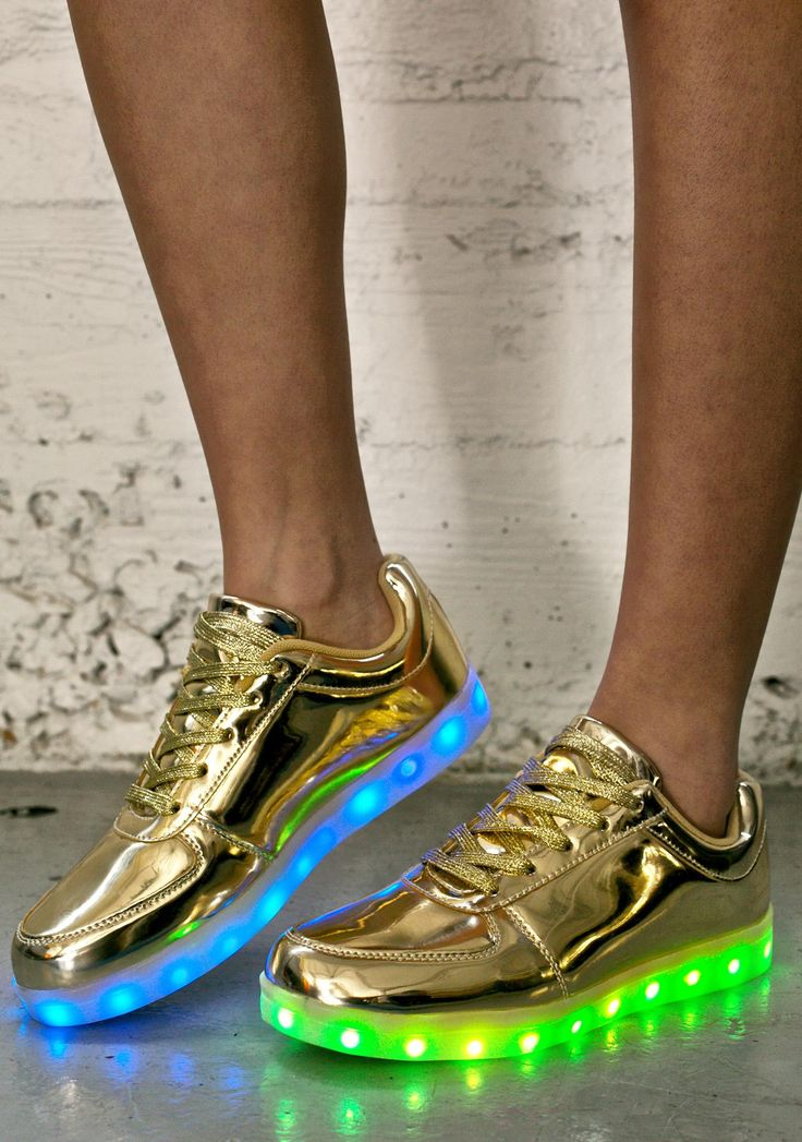 Finish Line Light Up Sneakers cuz everyone wants to emulate yer vibe, bb! These incredible light up sneakers feature an ultra luxxxurious gold construction, metallic lace ups, padded insole 'n ankle for maxxx comfort, and can get charged up wit a concealed USB on the inner side. Light up soles are controlled by an easy ta reach button by tha USB and feature 7 static colors, and 4 color changing programs!