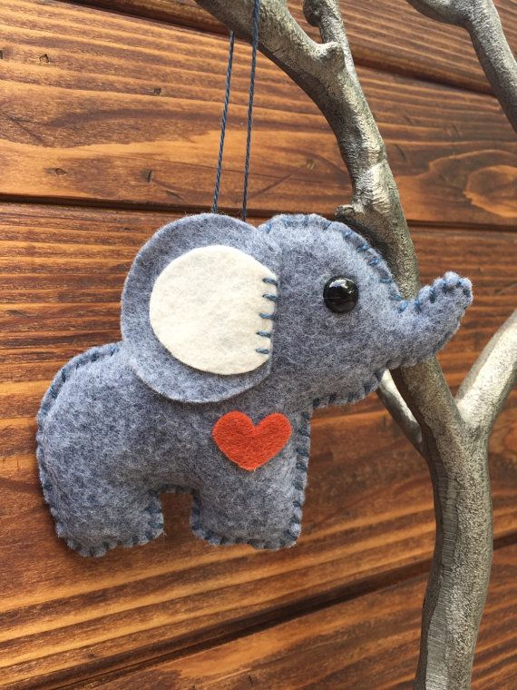 This little soft wool felt elephant ornament is an original design by myself which is hand cut, sewn and stuffed with cotton. Can also be purchased as