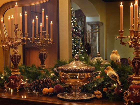 "An 18th century French sideboard is ready for serving in the formal dining room. A silver tureen sparkles in the candlelight. - ""Decorating for Christmas, Old World Style"""