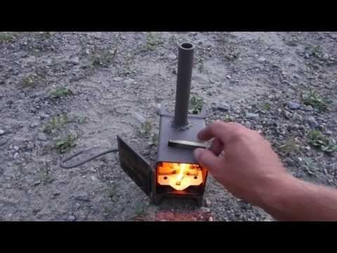 Home made wood stove burning wood