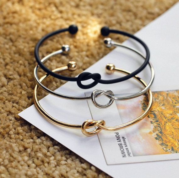 """This bracelet is perfect for bridesmaids proposals or bridesmaid's gifts. Ask them to help you Tie The Knot or thank for helping you """"Tie the Knot"""". Either way they will love it!  This bracelet is also just a great accessory that is personalized and unique!  *These bracelets are adjustable to fit different sizes wrists. The cuff opening is approx. Measurements: 6.5 Inches Long 2.5 Inches Wide"""
