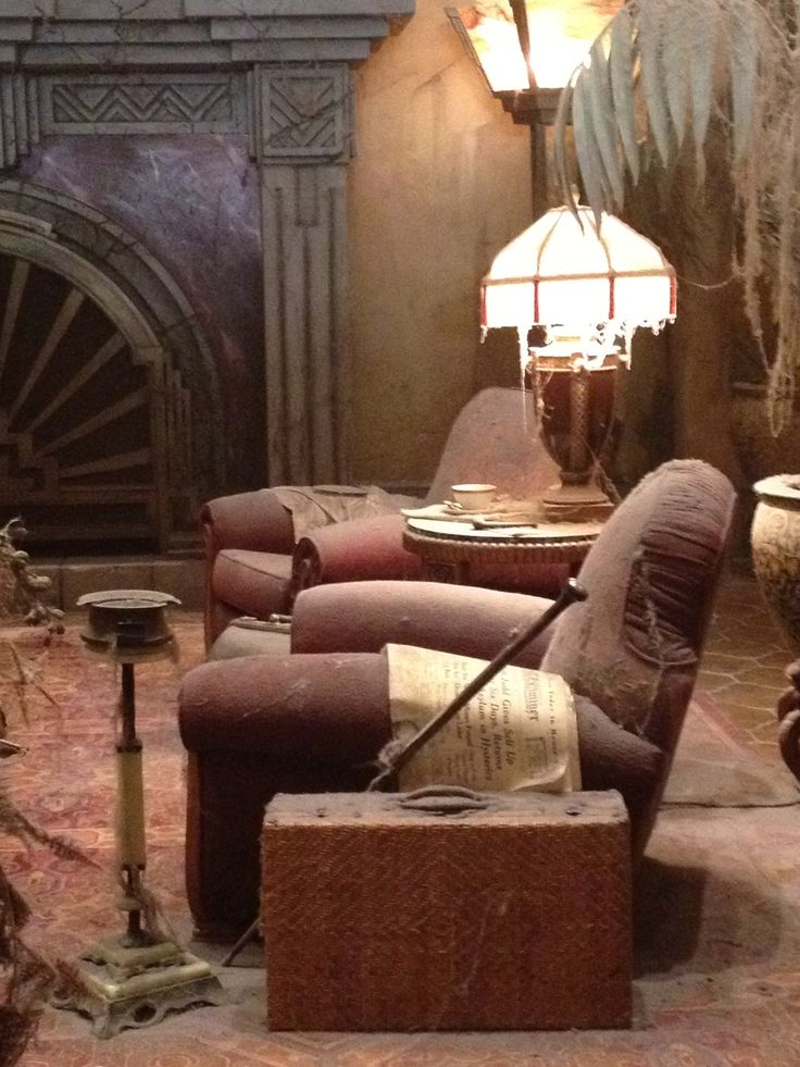 Suitcase by the chair. Tower of Terror- The Hollywood Tower Hotel lobby