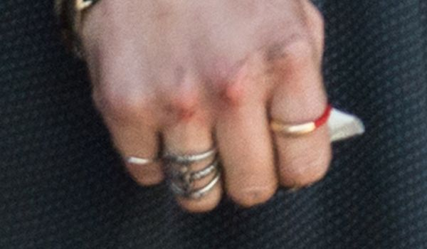 Cropped photo showing Scarlet Witch Wanda Maximoff's large silver ring on her ring-finger right-hand from Avengers 2 Age of Ultron