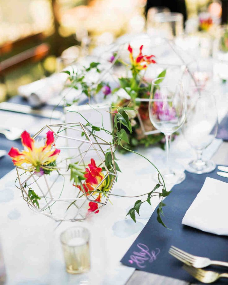 A Fun, Colorful Wedding in Guerneville, California | Martha Stewart Weddings - In addition to the flowers, modern geometric shapes with flowers inside decorated the tables at the couple's colorful outdoor wedding. #weddingdecor #weddingideas #tabledecor