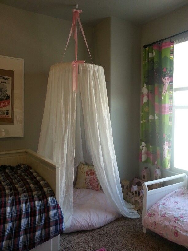 "Hula Hoop Tent Canopy:  I used a 36"" diameter hula hoop and 3 curtain panels from Target.  I found a round dog bed from Costco for $26 compared to the $80 papasan cushion found on other pins.  I covered the dog bed with an extra crib sheet I had."
