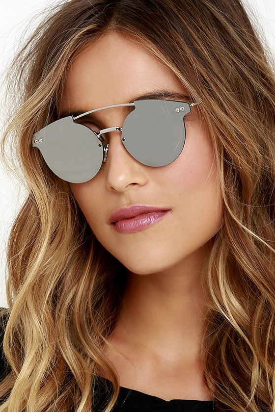 There's nothing ordinary about your fashion choices, which is why you naturally gravitate to the Spitfire Trip Hop Silver Mirrored Sunglasses! Sturdy silver sunnies have a unique frame-less look with flat, silver mirrored lenses and a curving bridge. 100% UV protection. Protective hard case and cloth included.