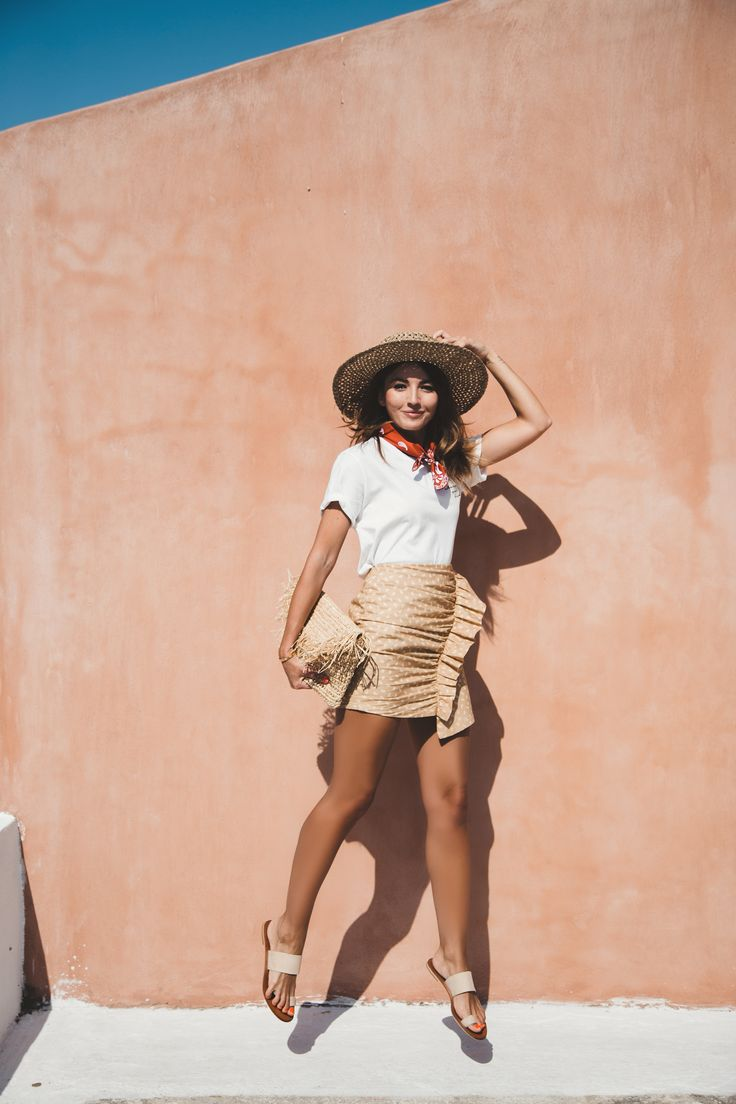 HELLO SANTORINI - Lovely Pepa by Alexandra. White graphic t-shirt+camel printed ruffle skirt+nude flat sandals+straw clutch+straw sunhat+red bandana. Summer Casual Outfit 2017