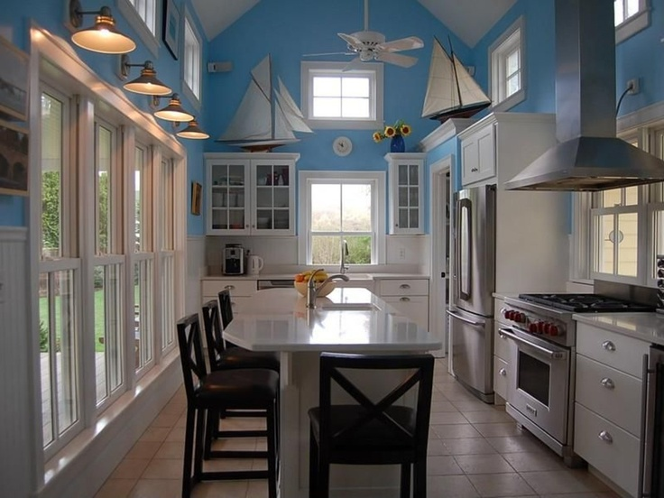 Those pond yachts really add so much to this kitchen. Island, Marble - simple, Breakfast Bar, Cottage, Glass, European, Flat Panel, U-Shaped, Undermount, Wall sconce