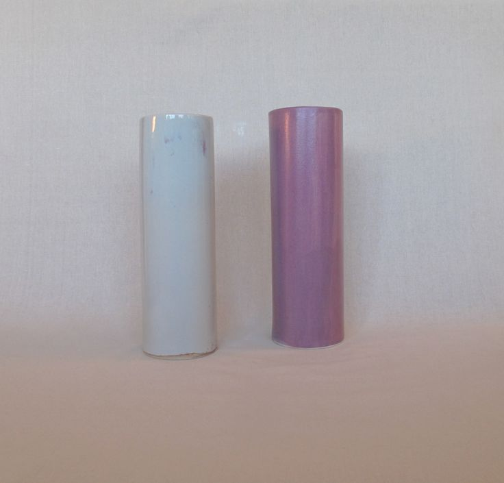 Slipcast ikebana cylinders by Janine Flew