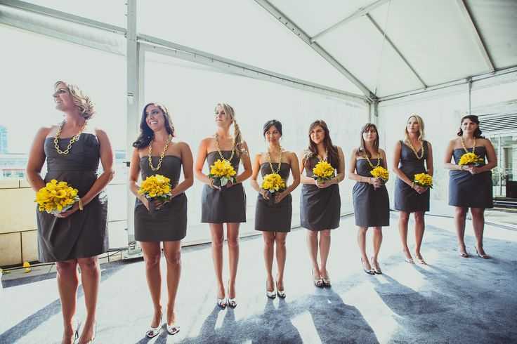 Modern grey bridesmaid dresses make yellow bouquets pop {Photo by IQPHoto Studio by Project Wedding}