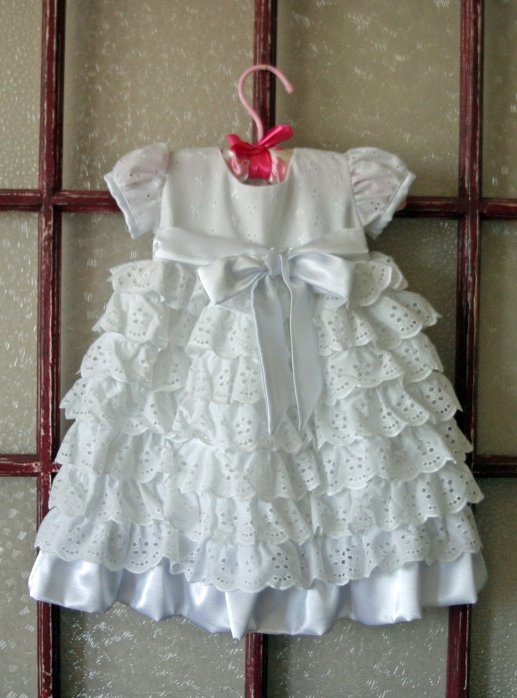 Eyelet Christening gown for a baby girl. Eyelet is a pretty yet versatile and durable fabric that has been around for a long time.