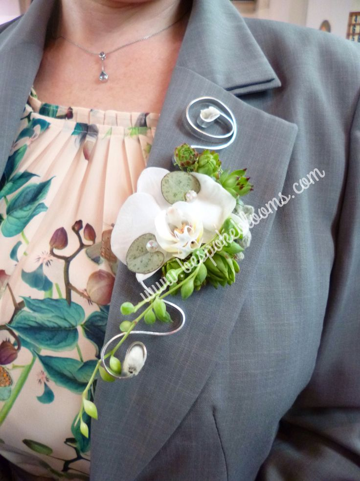Contemporary orchid corsage with sempervivum for wedding or celebration