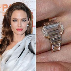 Angelina Jolie's engagement ring was designed by Brad Pitt along with jeweler Robert Procop. The ring has a center stone with an elongated tablet shape and is mounted with a galaxy of smaller stones, graduated in size and faceted to match.