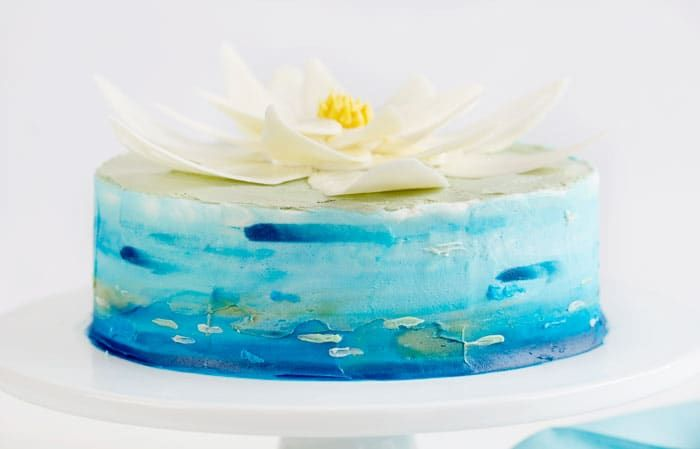 White chocolate wafers and tinted buttercream come together to create an easy Water Lily Cake!