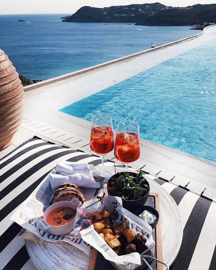 Aperol Spritz, Greek food and this breathtaking view ! Enjoy the Myconian Villa Collection lifestyle