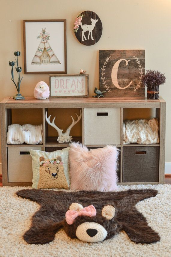 Add rustic charm to any room with this adorable handmade faux bear rug! This bears body is crafted from faux grizzly fur  Regular size measures 50 x 32 Large size measures 65 x 50 also available  This bear rug is custom made and can be modified to suit your room (with or without crochet bow.) I would be happy to work with you to create the perfect custom bear rug for your room. The bears muzzle and ears are crocheted with a cream-colored yarn with a black felt nose. The bear rug is NOT…
