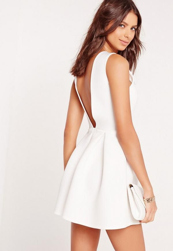 This lwd (little white dress) has weekend goals written all over it, with its square neck, open back and skater style.