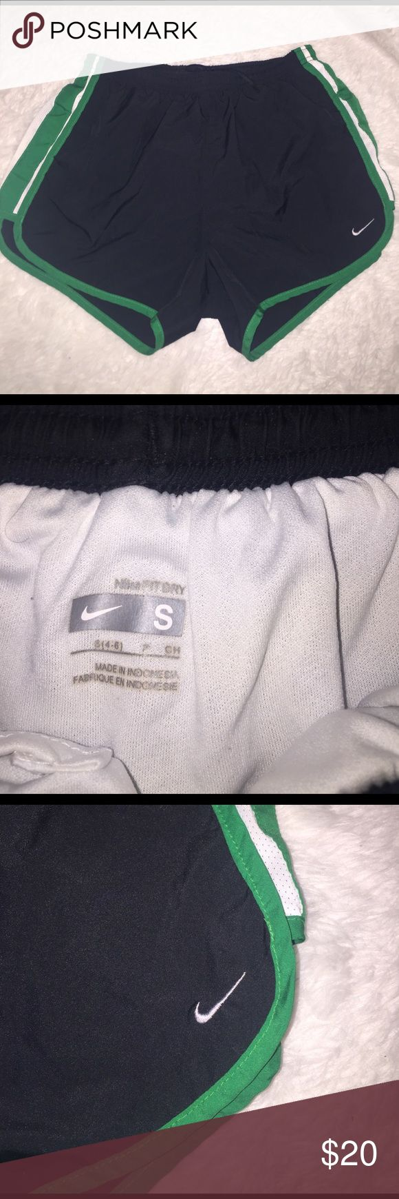 Nike shorts black Nike shorts. in perfect condition good for running jogging and other sports. Trendy black color with white and green side strips. Looks terrific with anything Nike Shorts