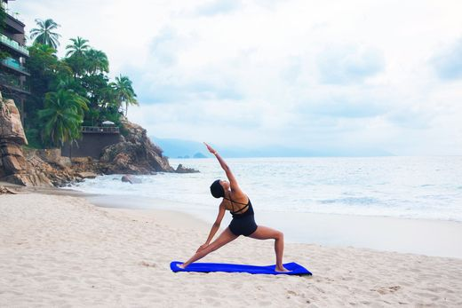 Paradise is practicing your favorite postures on your own private beach. Our oceanfront resort in Puerto Vallarta is the epitome of recharge and relaxation. Breath easy, your all-inclusive vacation is just a booking away. | Hyatt Ziva Puerto Vallarta