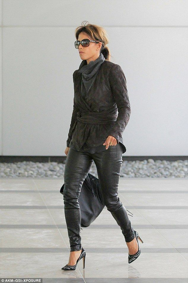 Hell for leather! Halle Berry is even dressed to impress when she's heading for a business...