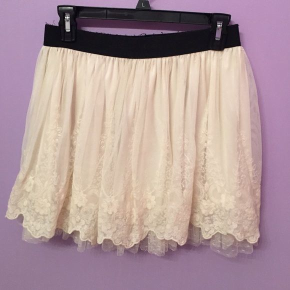 American Rag Skirt Very gorgeous skirt with lace and tulle. Has a black stretch band that has fuzz on it and has seen better days lol by overall in good condition. Very cute and flirty. 100% polyester. American Rag Skirts Mini