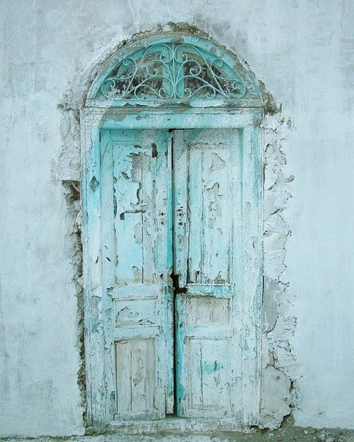Ornate light blue chipped doors