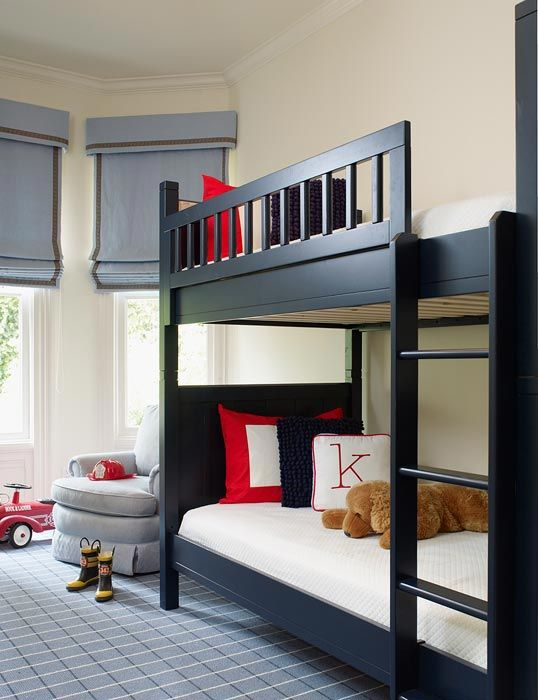 blue & black boy's nursery design with glossy black bunk beds, blue rug, blue cornice boxes and roman shades and red black velvet pillows
