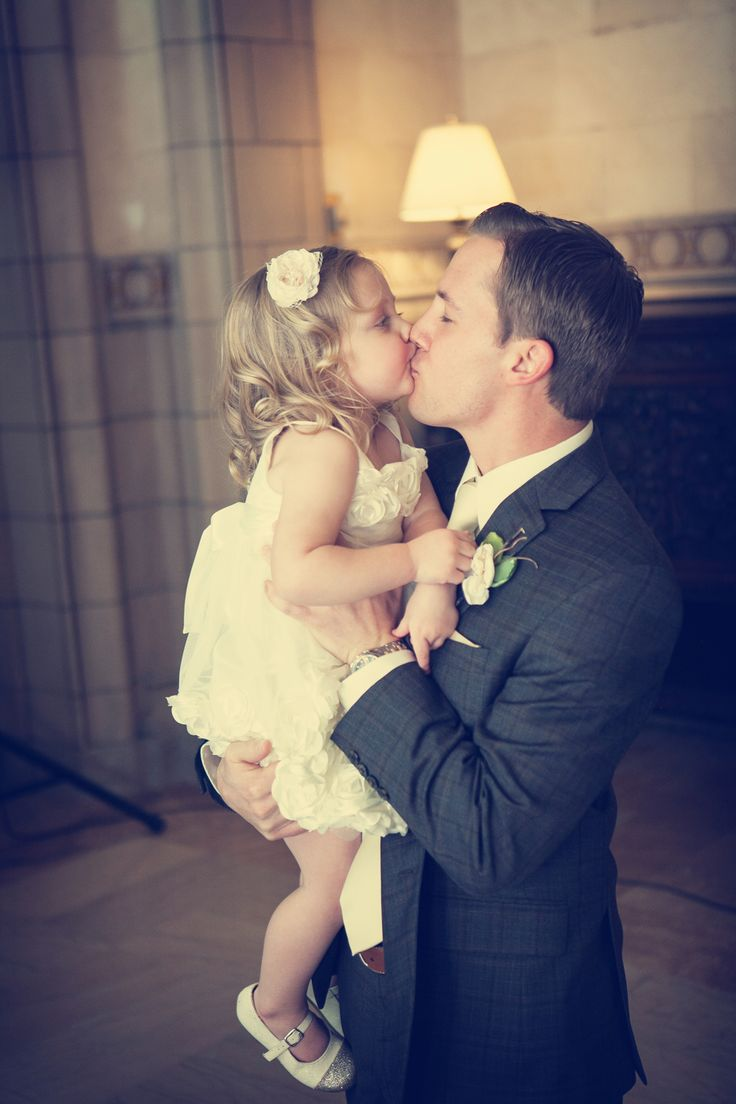 How adorable is this photo of the groom and flower girl? Photo by Chris K. #WeddingPhotographersMN