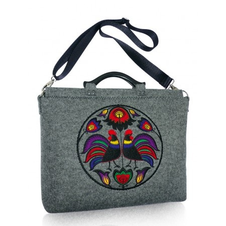Big laptop bag with a multi-color embroidery inspired by a Lowicz region handicraft. Shoulder strap is detatchable and adjustable. Inside finished with a nice quilted lining with one zip pocket and one cell phone pocket. Handmade