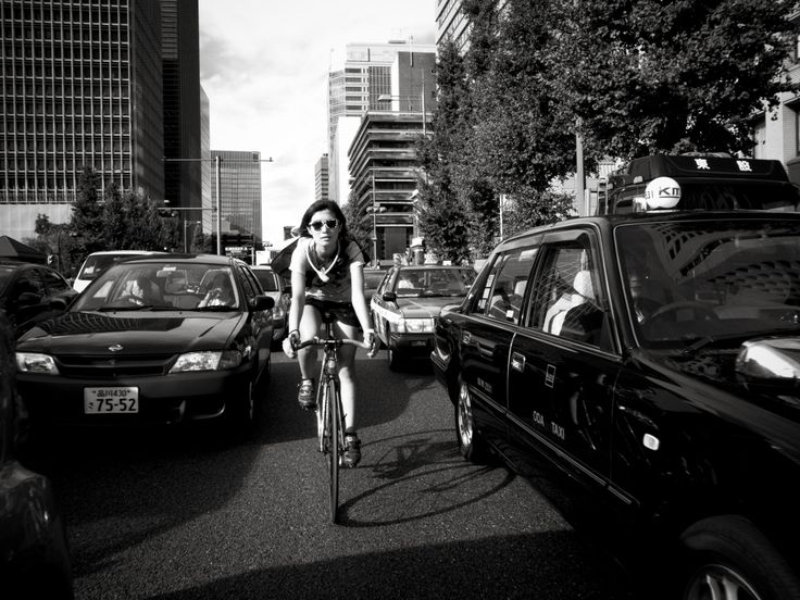 girl on bike versus traffic jam