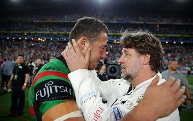 Russel Crowe and Sam Burgess embrace after the South Sydney Rabbitohs win the Australian NRL title