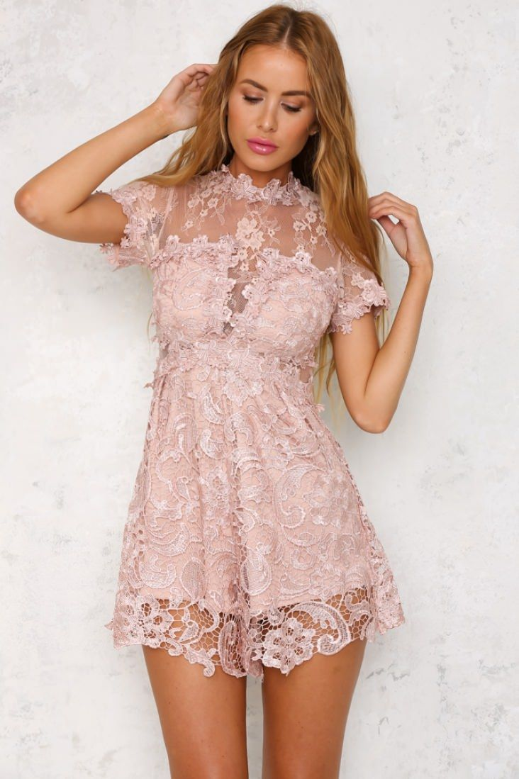 The Lace For Days Playsuit has short sleeves, a high neck, a sweetheart bodice over sheer lace fabric, and an invisible back zip. We're in love with the lace detailing! Style with simple camel sandals and triple stack rings!   Playsuit. Lined. Cold hand wash only. Model is standard XS and is wearing XS. True to size. Non-stretchy fabric. Print may vary in placement. Polyester.