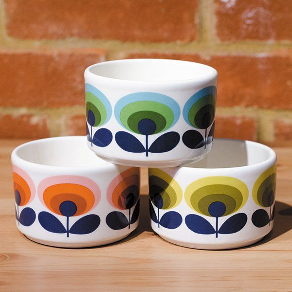 A set of 3 Orla Kiely ramekins in the 70s oval flower pattern. One bowl of each of the three seventies colours, red, green and yellow
