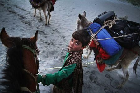 Wakhi Horse Boy Photo by Usman Jamshed — National Geographic Your Shot