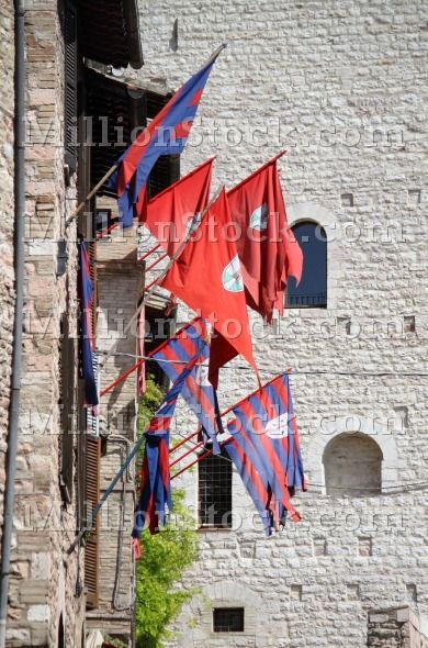 Flags of a district in the medieval town of Assisi, Ital