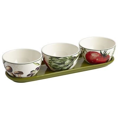 Get your daily vegetable servings with a side of rustic charm using our four-piece condiment set. Crafted of ironstone and finished with a colorful glaze depicting mushrooms, artichokes and tomatoes, it provides ample space for serving ketchup, mustard and other condiments. Use your imagination and dig in.
