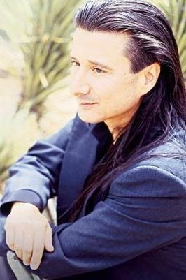 Steve Perry - Post Journey and with the hair that makes me smile more than I should...
