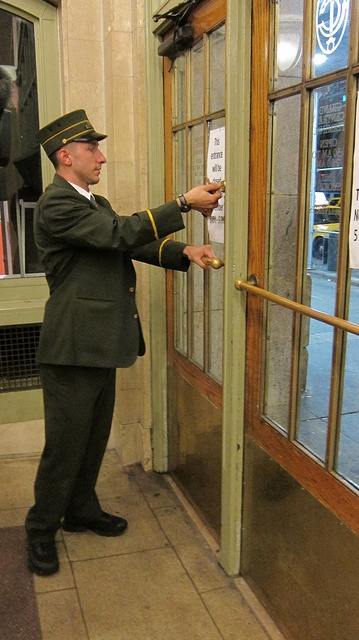 Assistant Station Master Cory Harris locked the main entrance to Grand Central Terminal, at 42nd Street and Park Avenue, after the last train departed at 7:10 p.m. on Sunday, October 28. Grand Central closed in advance of Hurricane Sandy.    Photo: Metropolitan Transportation Authority / Aaron Donovan