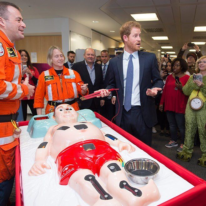 """It took just 30 seconds for Prince Harry to """"kill"""" his patient on a life-sized game of Operation manned by the London Air Ambulance at ICAP's Charity Day! (: Getty Images)  via ✨ @padgram ✨(http://dl.padgram.com)"""