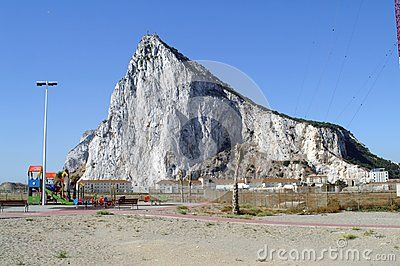 The Rock of Gibraltar is the state of Gibraltar from the Spanish border. Gibraltar is a British Overseas Territory located at the southern tip of the Iberian Peninsula. The landscape is dominated by the Rock of Gibraltar at the foot of which is a densely populated city area, home to over 30,000 people.